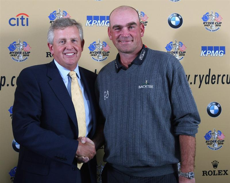 DUBAI, UNITED ARAB EMIRATES - JANUARY 28:  Colin Montgomerie of Scotland, the 2010 Ryder Cup Captain, and Thomas Bjorn, Chairman of the Players Committee attend a press conference to anounce the 2010 Ryder Cup Captain prior to the Dubai Desert Classic on the Majlis Course on January 28, 2009 in Dubai,United Arab Emirates.  (Photo by Ross Kinnaird/Getty Images)