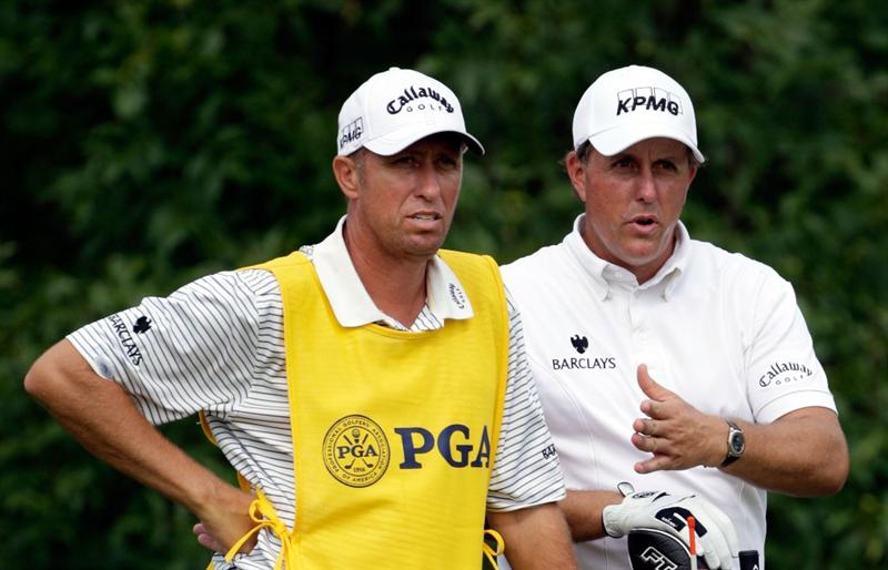 CHASKA, MN - AUGUST 15:  Phil Mickelson (R) chats with his caddie Jim Mackay on the tenth tee during the third round of the 91st PGA Championship at Hazeltine National Golf Club on August 15, 2009 in Chaska, Minnesota.  (Photo by Jamie Squire/Getty Images)