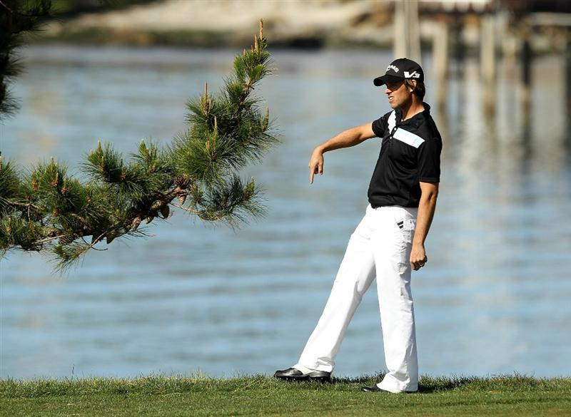 PEBBLE BEACH, CA - FEBRUARY 13:  Aaron Baddeley of Australia looks for his ball on the 6th hole during the final round of the AT&T Pebble Beach National Pro-Am at the Pebble Beach Golf Links on February 13, 2011 in Pebble Beach, California.  (Photo by Ezra Shaw/Getty Images)