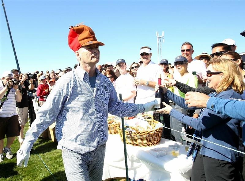 PEBBLE BEACH, CA - FEBRUARY 12:  Actor Bill Murray hands out bottles of wine that he took early in the hole during the third round of the AT&T Pebble Beach National Pro-Am at the Pebble Beach Golf Links on February 12, 2011 in Pebble Beach, California.  (Photo by Ezra Shaw/Getty Images)