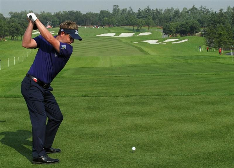 SHANGHAI, CHINA - NOVEMBER 05:  Luke Donald of England hits his tee-shot on the first hole during the second round of the WGC-HSBC Champions at Sheshan International Golf Club on November 5, 2010 in Shanghai, China.  (Photo by Andrew Redington/Getty Images)
