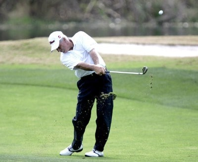 Curtis Strange hits from the 13th fairway during the second round of the Outback Steakhouse Pro-Am at the TPC of Tampa, Florida., Feb. 25, 2006.Photo by Hunter Martin/WireImage.com
