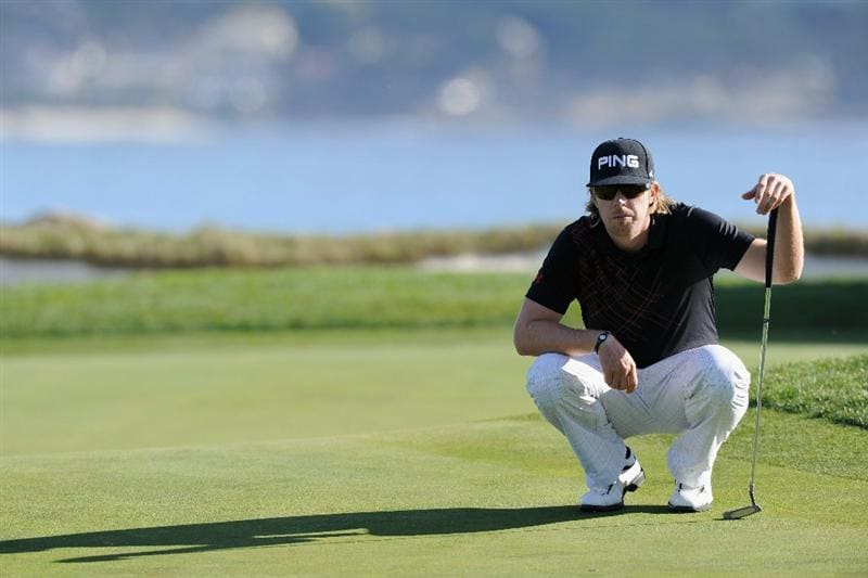 PEBBLE BEACH, CA - FEBRUARY 11:  Hunter Mahan lines up his putt on the 18th hole during the second round of the AT&T Pebble Beach National Pro-Am at the Pebble Beach Golf Links on February 11, 2011  in Pebble Beach, California  (Photo by Stuart Franklin/Getty Images)