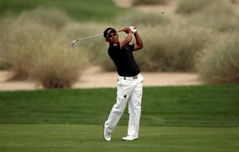 DUBAI, UNITED ARAB EMIRATES - FEBRUARY 05:  Thongchai Jaidee of Thailand plays his second shot on the 16th hole during the second round of the Omega Dubai Desert Classic on February 5, 2010 in Dubai, United Arab Emirates.  (Photo by Andrew Redington/Getty Images)