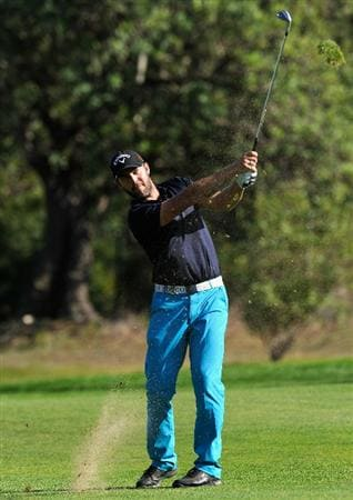 CASTELLON DE LA PLANA, SPAIN - OCTOBER 23:  Christian Nilsson of Sweden plays his approach shot on the 10th hole during the third round of the Castello Masters Costa Azahar at the Club de Campo del Mediterraneo on October 23, 2010 in Castellon de la Plana, Spain.  (Photo by Stuart Franklin/Getty Images)
