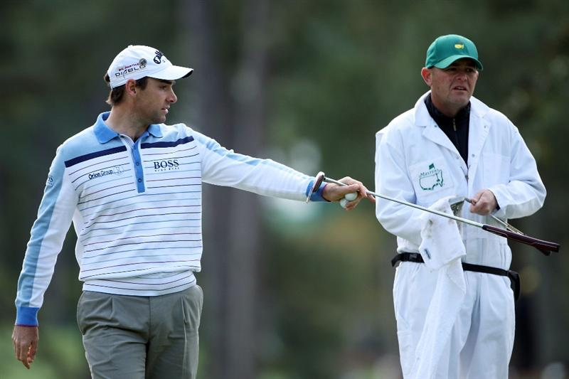 AUGUSTA, GA - APRIL 07:  Oliver Wilson of England chats with his caddie Richard Hill during a practice round prior to the 2009 Masters Tournament at Augusta National Golf Club on April 7, 2009 in Augusta, Georgia.  (Photo by Andrew Redington/Getty Images)