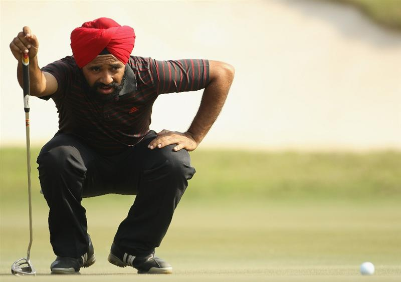 NEW DELHI, INDIA - FEBRUARY 19:  Sujjan Singh of India lines up a putt during the third round of the Avantha Masters held at The DLF Golf and Country Club on February 19, 2011 in New Delhi, India.  (Photo by Ian Walton/Getty Images)