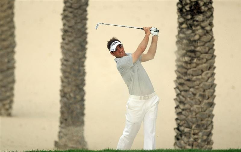 DUBAI, UNITED ARAB EMIRATES - FEBRUARY 04:  Nick Dougherty of England plays his second shot to the par 4, 14th hole during the first round of the 2010 Omega Dubai Desert Classic on the Majilis Course at the Emirates Golf Club on February 4, 2010 in Dubai, United Arab Emirates.  (Photo by David Cannon/Getty Images)