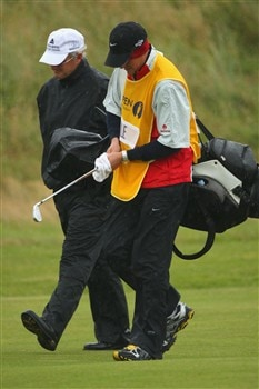 SOUTHPORT, UNITED KINGDOM - JULY 17:  Sandy Lyle of Scotland walks down the 1st hole with his son and caddy Stewart during the First Round of the 137th Open Championship on July 17, 2008 at Royal Birkdale Golf Club, Southport, England.  (Photo by Andrew Redington/Getty Images)