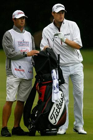 ATLANTA - SEPTEMBER 26:  Nick Watney (R) pulls a club from his bag while alongside his caddie Chad Reynolds (L) on the 14th hole during the final round of THE TOUR Championship presented by Coca-Cola at East Lake Golf Club on September 26, 2010 in Atlanta, Georgia.  (Photo by Scott Halleran/Getty Images)