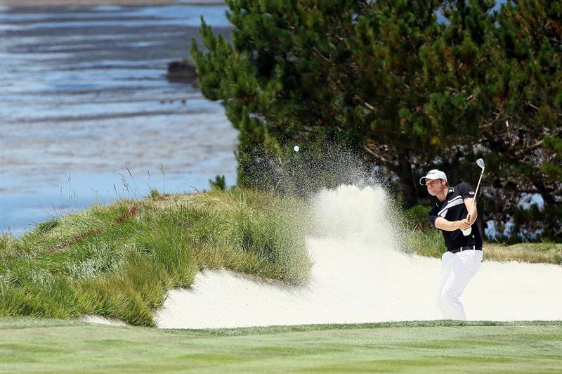 PEBBLE BEACH, CA - JUNE 19:  Nick Watney plays from a bunker on the fourth hole during the third round of the 110th U.S. Open at Pebble Beach Golf Links on June 19, 2010 in Pebble Beach, California.  (Photo by Jeff Gross/Getty Images)