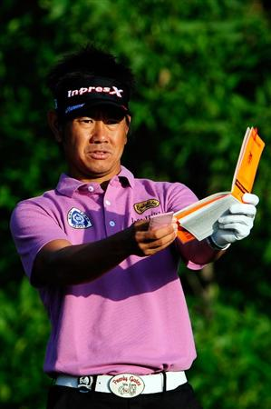 CHASKA, MN - AUGUST 13:  Hiroyuki Fujita of Japan checks his yardage book on the tenth tee during the first round of the 91st PGA Championship at Hazeltine National Golf Club on August 13, 2009 in Chaska, Minnesota.  (Photo by Sam Greenwood/Getty Images)