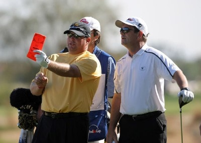 Singer Huey Lewis takes some advice from Jason Gore on the 16th hole during the first round of the 49th Bob Hope Chrysler Classic at the Silverrock Resort on January 16, 2008 in La Quinta, California. PGA TOUR - 2008 Bob Hope Chrysler Classic - Round OnePhoto by Harry How/WireImage.com