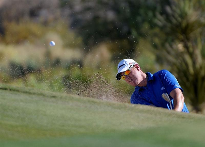 LAS VEGAS, NV- OCTOBER 16: Greg Owens blasts out of the greenside bunker on the 15th hole during the second round of the Justin Timberlake Shriners Hospitals for Childeren Open at the TPC Summerland on October 16, 2009  in Las Vegas, Nevada. (Photo by Marc Feldman/Getty Images)