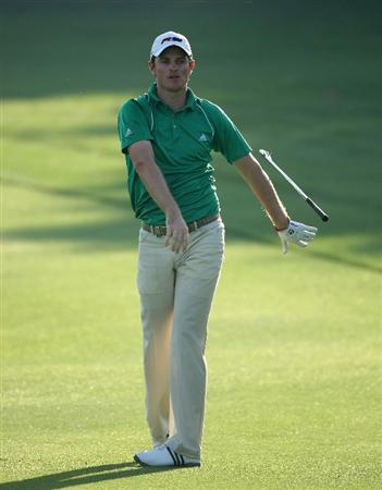 DUBAI, UNITED ARAB EMIRATES - JANUARY 31:  Justin Rose of England drops his club after his second shot on the sixth hole during the third round of the Dubai Desert Classic on the Majilis course at Emirates Golf Club on January 31, 2009 in Dubai, United Arab Emirates.  (Photo by Andrew Redington/Getty Images)