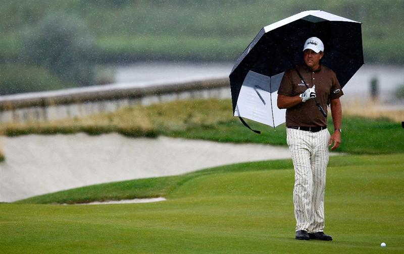 JERSEY CITY, NJ - AUGUST 28:  Phil Mickelson waits to play his second shot from the 18th fairway during round two of The Barclays on August 28, 2009 at Liberty National in Jersey City, New Jersey.  (Photo by Kevin C. Cox/Getty Images)