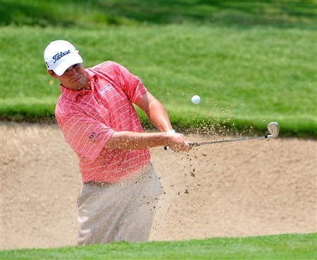 FORT WORTH , TX - MAY 24:  Johnson Wagner blasts out of the greenside bunker on the 1st hole during the third round of the Crowne Plaza Invitational at Colonial Country Club on May 24, 2008 in Fort Worth, Texas.  (Photo by Marc Feldman/Getty Images)