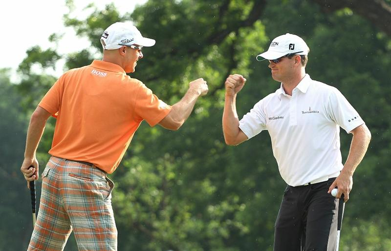FT. WORTH, TX - MAY 30:   Ben Crane (L) celebrates his birdie putt on the 18th green with playing partner Zach Johnson during the final round of the 2010 Crowne Plaza Invitational at the Colonial Country Club on May 30, 2010 in Ft. Worth, Texas.  (Photo by Scott Halleran/Getty Images)