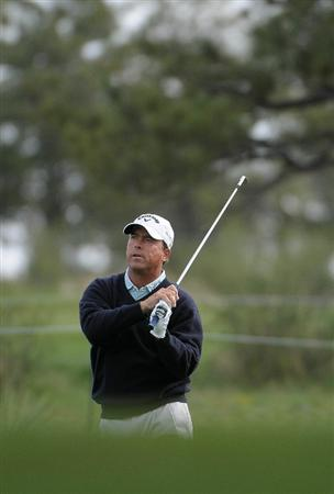 PARKER, CO. - MAY 27:   Olin Browne hits into the 10th hole during the first round of the Senior PGA Championship at the Colorado Golf Club  on May 27, 2010 in Parker, Colorado.  (Photo by Marc Feldman/Getty Images)
