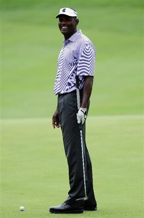 AKRON, OH - AUGUST 04:  Vijay Singh of Fiji reacts during a practice round of the World Golf Championship Bridgestone Invitational on August 4, 2009 at Firestone Country Club in Akron, Ohio.  (Photo by Stuart Franklin/Getty Images)