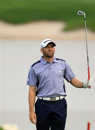 BAHRAIN, BAHRAIN - JANUARY 28:  Sergio Garcia of Spain plays his second shot at the 15th hole during the second round of the 2011 Volvo Champions held at the Royal Golf Club on January 28, 2011 in Bahrain, Bahrain.  (Photo by David Cannon/Getty Images)