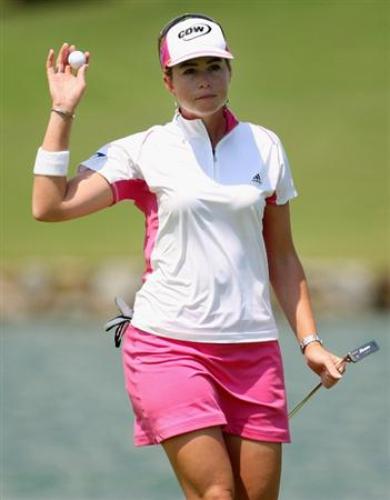 SINGAPORE - MARCH 06:  Paula Creamer of the USA  waves to the gallery after a putt during the second round of HSBC Women's Champions at the Tanah Merah Country Club on March 6, 2009 in Singapore.  (Photo by Ross Kinnaird/Getty Images)