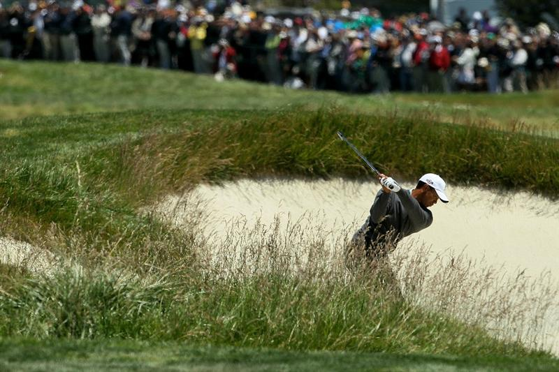 PEBBLE BEACH, CA - JUNE 17:  Tiger Woods hits from a bunker on the second hole during the first round of the 110th U.S. Open at Pebble Beach Golf Links on June 17, 2010 in Pebble Beach, California.  (Photo by Jeff Gross/Getty Images)