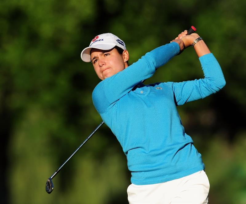 EVIAN-LES-BAINS, FRANCE - JULY 24:  Lorena Ochoa of Mexico plays her approach shot on the first hole during the second round of the Evian Masters at the Evian Masters Golf Club on July 24, 2009 in Evian-les-Bains, France.  (Photo by Stuart Franklin/Getty Images)