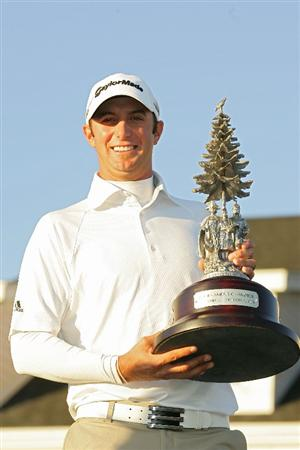VERONA, NY - OCTOBER 05: Dustin Johnson poses with the trophy after winning the Turning Stone Resort Championship at Atunyote Golf Club held on October 5, 2008 in Verona, New York.  (Photo by Michael Cohen/Getty Images)
