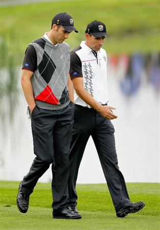 NEWPORT, WALES - SEPTEMBER 28:  Ross Fisher of Europe chats with Padraig Harrington (R) during a practice round prior to the 2010 Ryder Cup at the Celtic Manor Resort on September 28, 2010 in Newport, Wales.  (Photo by Sam Greenwood/Getty Images)