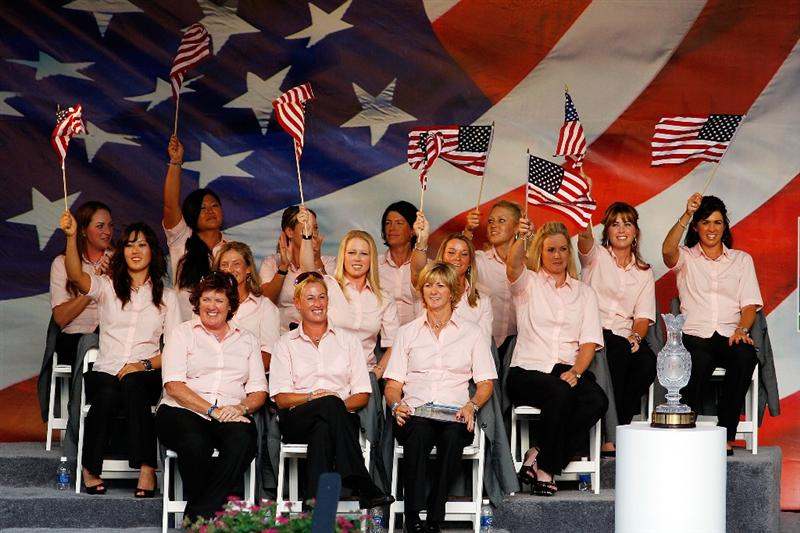 SUGAR GROVE, IL - AUGUST 20:  Members of the U.S. Team wave American flags on stage during the opening ceremonies for the 2009 Solheim Cup at Rich Harvest Farms on August 20, 2009 in Sugar Grove, Illinois.  (Photo by Chris Graythen/Getty Images)