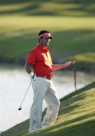 AVONDALE, LA - APRIL 23: Eric Axley reacts after making a chip to the 18th green during the first round of the Zurich Classic at TPC Louisiana on April 23, 2009  in Avondale, Louisiana. (Photo by Dave Martin/Getty Images)