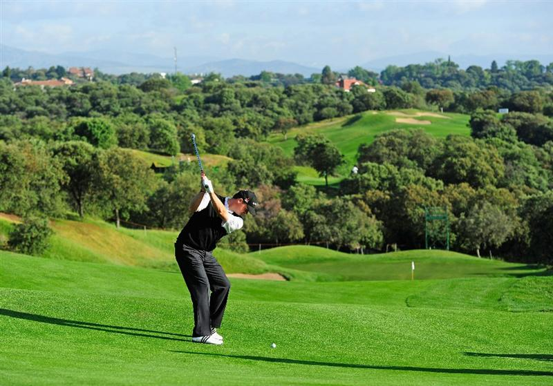 MADRID, SPAIN - MAY 26:  Paul Lawrie of Scotland plays his approach shot during the Pro-Am of the Madrid Masters at Real Sociedad hipica Espanola club de campo on May 26, 2010 in Madrid, Spain.  (Photo by Stuart Franklin/Getty Images)