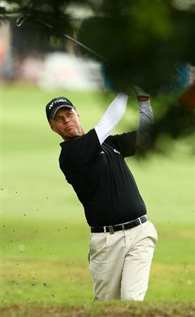 PERTH, AUSTRALIA - NOVEMBER 21:  Gary Wolstenhome of England plays an approach shot on the 1st hole during day three of the 2010 Australian Senior Open at Royal Perth Golf Club on November 21, 2010 in Perth, Australia.  (Photo by Paul Kane/Getty Images)