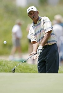 Mark James chips onto the 18th green during the second round of the U.S. Senior Open at Prairie Dunes Country Club in Hutchinson, Kansas on July 7, 2006.Photo by G. Newman Lowrance/WireImage.com