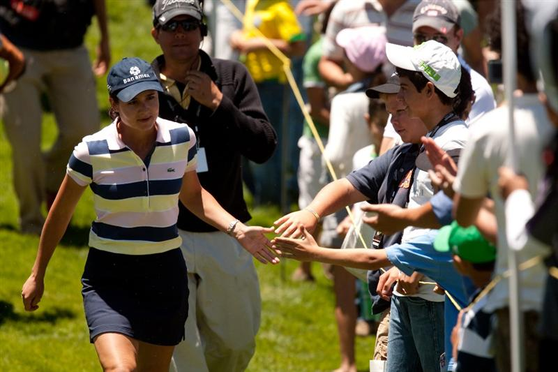 MORELIA, MEXICO - MAY 1: Lorena Ochoa of Mexico exchanges handshakes with fans during the third round of the Tres Marias Championship at the Tres Marias Country Club on May 1, 2010 in Morelia, Mexico. (Photo by Darren Carroll/Getty Images)