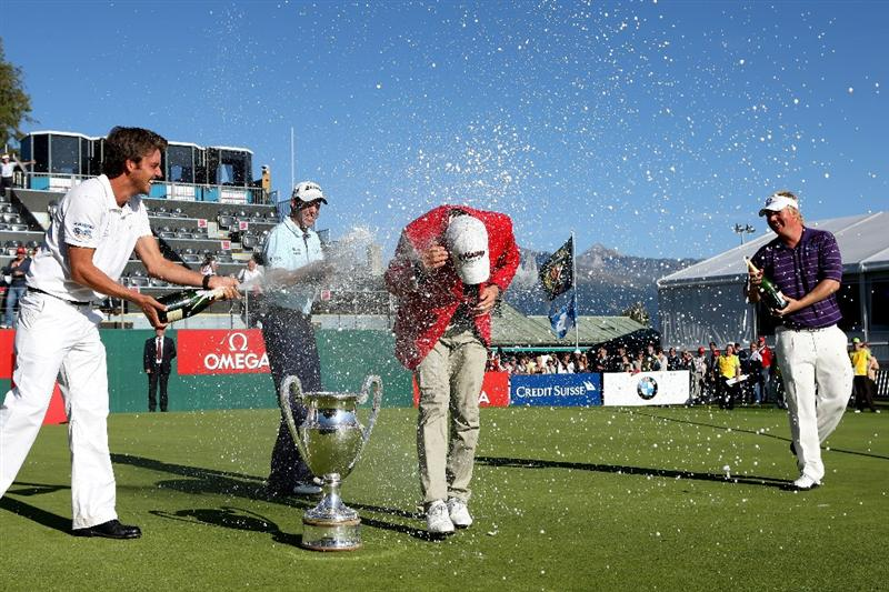 CRANS, SWITZERLAND - SEPTEMBER 06:  The winner Alexander Noren of Sweden (red jacket) is sprayed with champagne by (from left to right) Julien Clement of Switzerland, Bradley Dredge of Wales and Ross McGowan of England during the prize-giving for The Omega European Masters at Crans-Sur-Sierre Golf Club on September 6, 2009 in Crans Montana, Switzerland.  (Photo by Andrew Redington/Getty Images)