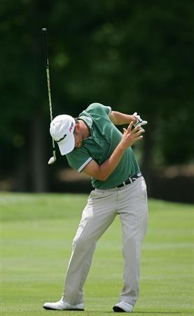 SILVIS, IL - JULY 11:  Spencer Levin of the USA is struck by his club as it returns to earth during the continuation of the second round of the John Deere Classic at TPC Deere Run held on July 11, 2009 in Silvis, Illinois.  (Photo by Michael Cohen/Getty Images)