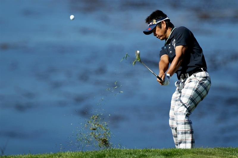 PEBBLE BEACH, CA - JUNE 17:  Hiroyuki Fujita of Japan plays a shot on the eighth hole during the first round of the 110th U.S. Open at Pebble Beach Golf Links on June 17, 2010 in Pebble Beach, California.  (Photo by Donald Miralle/Getty Images)