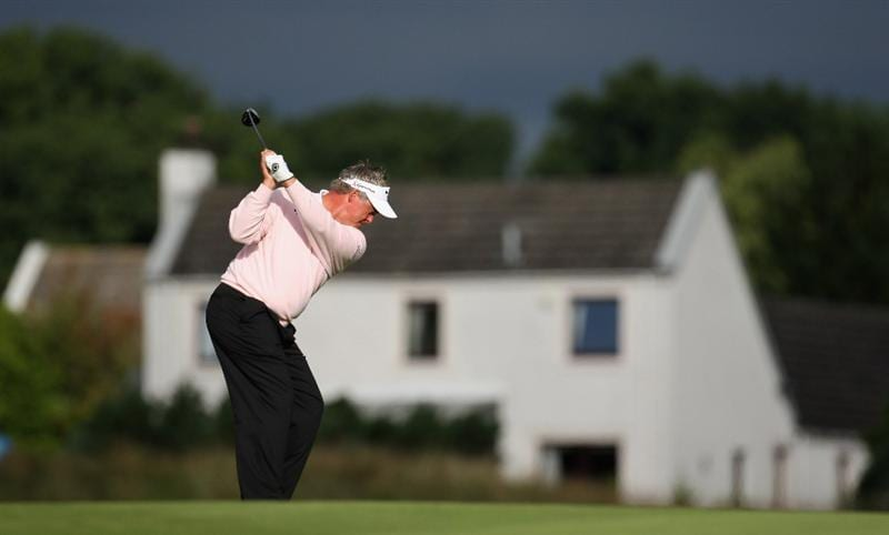 PERTH, UNITED KINGDOM - AUGUST 29: Darren Clarke of Northern Ireland plays his second shot to the par five 12th hole during the second round of The Johnnie Walker Championship at Gleneagles on August 29, 2008 at the Gleneagles Hotel and Resort in Perthshire, Scotland.  (Photo by Ross Kinnaird/Getty Images)