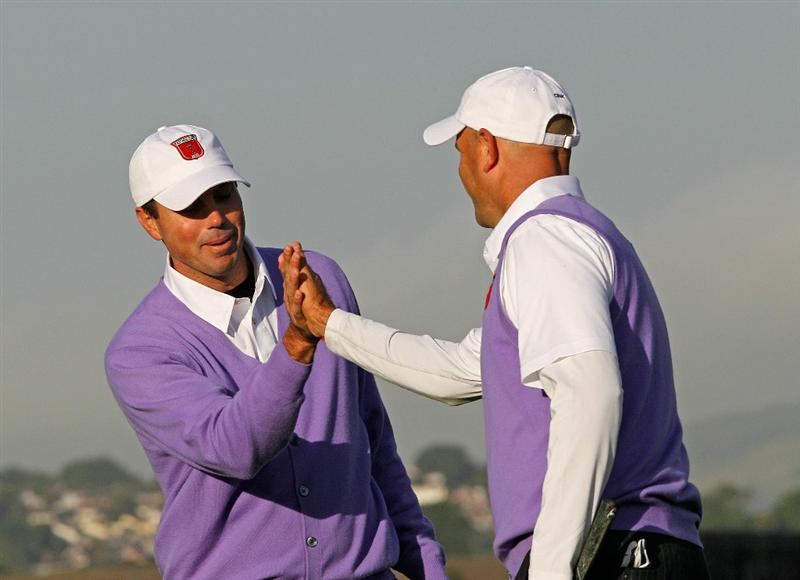 NEWPORT, WALES - OCTOBER 02:  Stewart Cink of the USA (R) celebrates with Matt Kuchar on the 14th green during the rescheduled Morning Fourball Matches during the 2010 Ryder Cup at the Celtic Manor Resort on October 2, 2010 in Newport, Wales.  (Photo by Sam Greenwood/Getty Images)