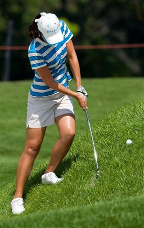 SINGAPORE - MARCH 06:  Ji Young Oh of South Korea chips from the rough during the second round of HSBC Women's Champions at the Tanah Merah Country Club on March 6, 2009 in Singapore.  (Photo by Victor Fraile/Getty Images)