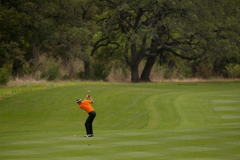 SAN ANTONIO, TX - APRIL 14: Jesper Parnevik of Sweden hits an approach shot during the first round of the Valero Texas Open at the AT&T Oaks Course at TPC San Antonio on April 14, 2011 in San Antonio, Texas. (Photo by Darren Carroll/Getty Images)