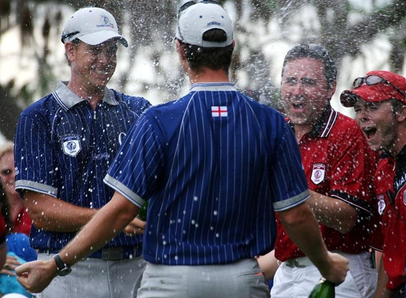 ORLANDO, FL - MARCH 17:  Henrik Stenson celebrates his teams victory by spraying champagne on teammate Justin Rose at the Tavistock Cup on March 17, 2009 at Lake Nona Country Club in Orlando, Florida.  (Photo by Marc Serota/Getty Images)