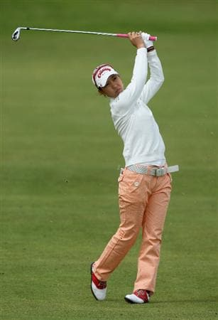 LYTHAM ST ANNES, ENGLAND - JULY 30:  Momoko Ueda of Japan hits her second shot on the 2nd hole during the first round of the 2009 Ricoh Women's British Open Championship held at Royal Lytham St Annes Golf Club, on July 30, 2009 in  Lytham St Annes, England.  (Photo by David Cannon/Getty Images)