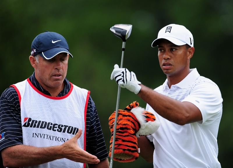 AKRON, OH - AUGUST 06:  Tiger Woods of USA and caddie Steve Williams on the fourth hole during the first round of the World Golf Championship Bridgestone Invitational on August 6, 2009 at Firestone Country Club in Akron, Ohio.  (Photo by Stuart Franklin/Getty Images)