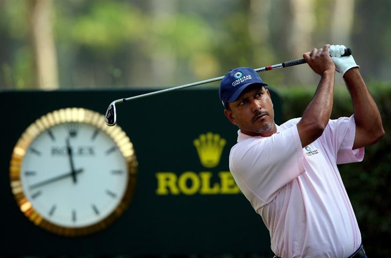 HONG KONG, CHINA - NOVEMBER 21:  Jeev Milkha Singh of India plays his tee shot on the eighth hole during the second round of the UBS Hong Kong Open at the Hong Kong Golf Club on November 21, 2008 in Fanling, Hong Kong.  (Photo by Stuart Franklin/Getty Images)