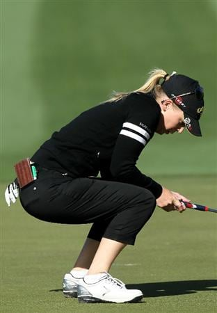 RANCHO MIRAGE, CA - APRIL 01:  Morgan Pressel reacts as she just misses a putt on the 12th hole during the first round of the Kraft Nabisco Championship at Mission Hills Country Club on April 1, 2010 in Rancho Mirage, California.  (Photo by Stephen Dunn/Getty Images)