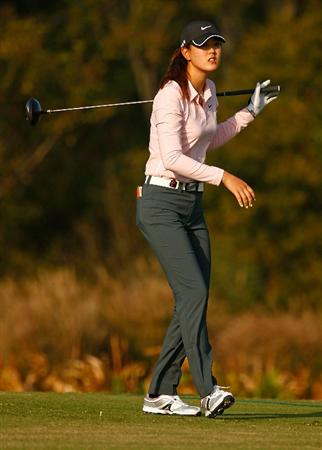 RICHMOND, TX - NOVEMBER 19:  Michelle Wie watches her tee shot on the 13th hole as she favors her sore left ankle during the first round of the LPGA Tour Championship presented by Rolex at the Houstonian Golf and Country Club on November 19, 2009 in Richmond, Texas.  (Photo by Scott Halleran/Getty Images)