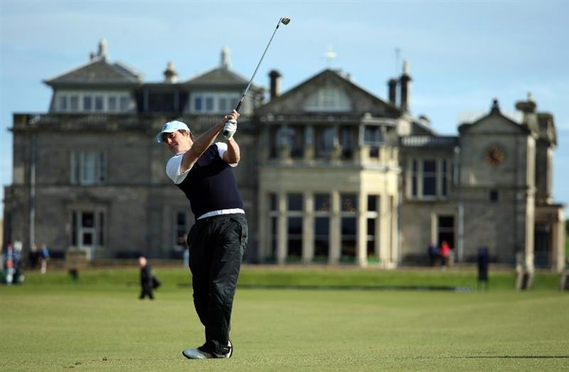 ST. ANDREWS, UNITED KINGDOM - SEPTEMBER 30: British film actor Hugh Grant plays his second shot to the first green during the practice round of The Alfred Dunhill Links Championship at The Old Course on September 30, 2008 in St Andrews, Scotland. (Photo by Warren Little/Getty Images)